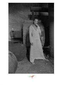 Bjlack and White imgae, 1970's transparent dress, dark haired model, nurse.
