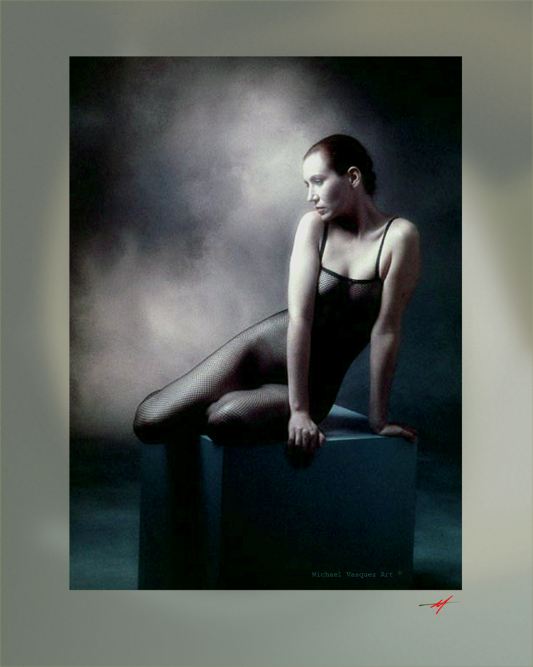 Near color of a model in black tights, sitting on a cube,