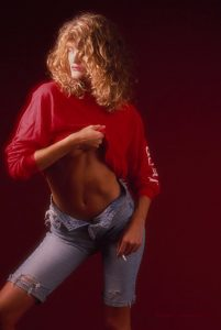 Danish model, color image three quarters, red top and jeans..