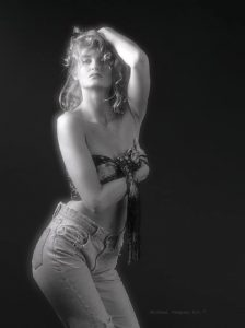 Danish Model, Black & White image, three quarters limage with a cute wrap around her bust, wearing jean.