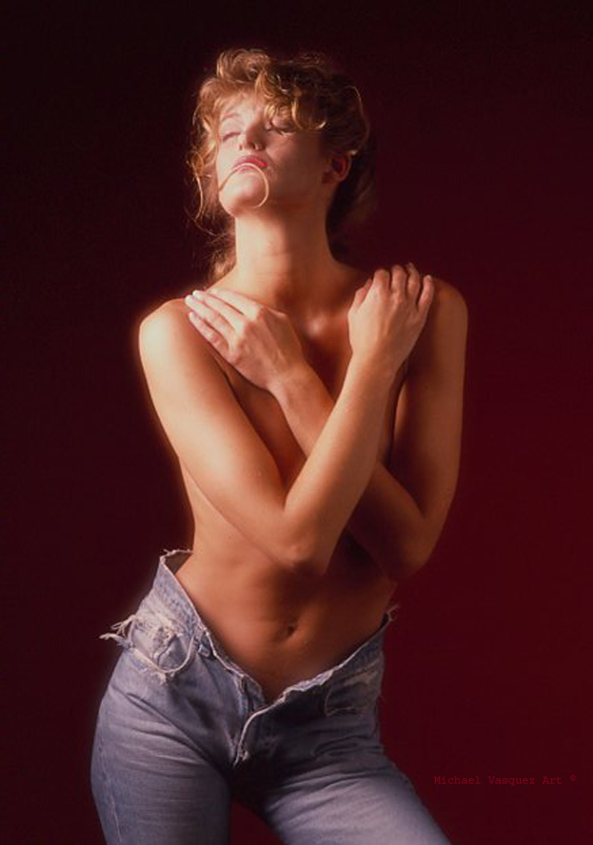Danish model, color image, topless with jean shorts.