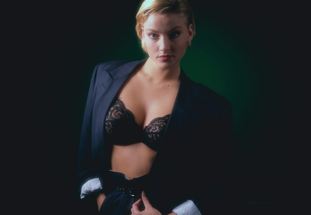 Blond Danish model, wearing suit, Black Bra