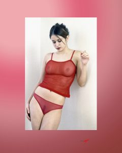 Young model, red panties and red shirt ,smoking, look down, color ima