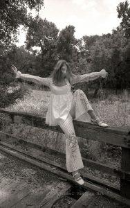 B & W image, late 1960's, high school friend, abandon night club, golf course, female model, white pants suit.