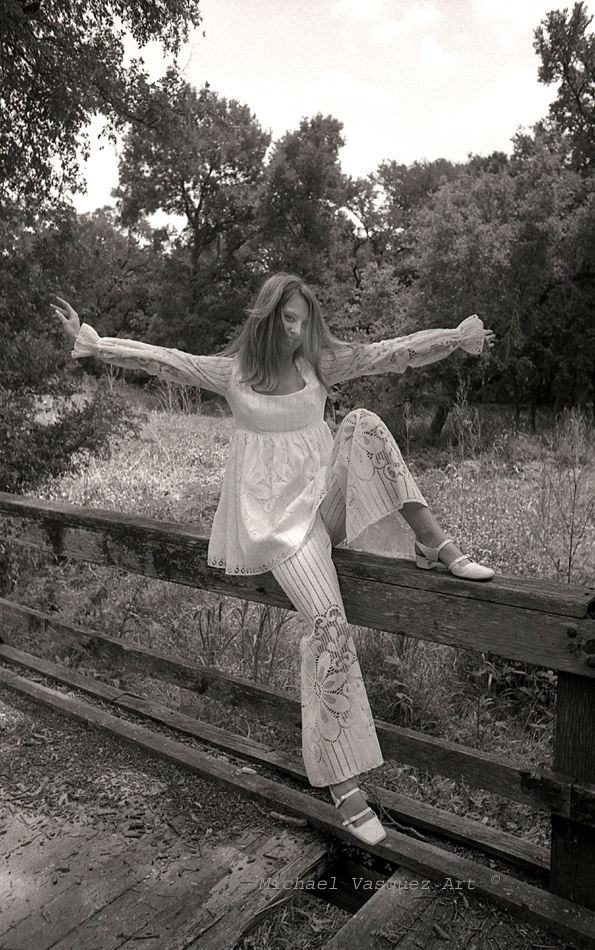 B & W image, late 1960's, high school friend, abandon night club, golf course, female model, white pants suit.
