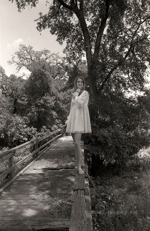 Black and white image, late 1960's, female model in white dress.s