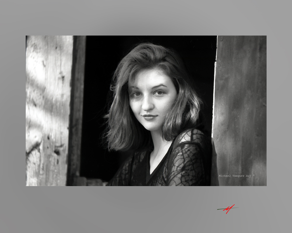 Black and white image, red haired female model, old milk shed, spider top, headshot.